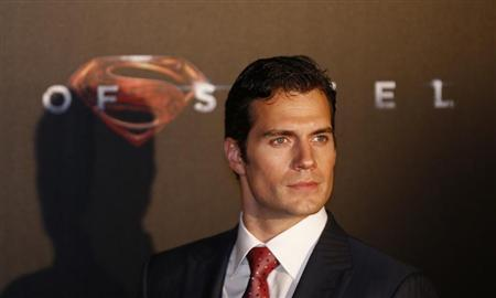 """Cast member Cavill poses for pictures after his arrival to the Australian premiere of """"Man of Steel"""" in central Sydney"""