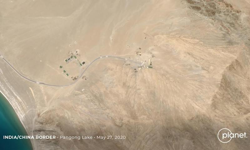 Satellite footage confirms build up of Chinese troops on disputed border.
