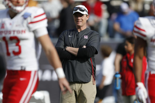 Houston head coach Major Applewhite watches as his team warms up before they play Army in the of Armed Forces Bowl NCAA college football game Saturday, Dec. 22, 2018, in Fort Worth, Texas. (AP)
