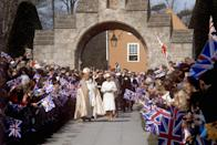 <p>Queen Elizabeth II and Rt Rev John Denis Wakeling, the Bishop of Southwell, enter Southwell Minster amid cheering crowds. (PA Archive) </p>