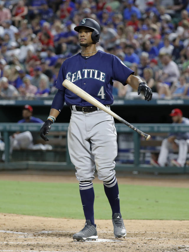 Seattle Mariners' Keon Broxton drops the bat at the plate after striking out, leaving the bases loaded in the fifth inning of a baseball game against the Texas Rangers in Arlington, Texas, Tuesday, July 30, 2019. (AP Photo/Tony Gutierrez)