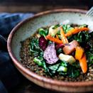 """<p>This earthy bowl of lentils bursting with Middle Eastern flavors is topped with leftover roasted root veggies from a large batch for an easy weeknight dinner. Keep it vegan or add a drizzle of plain yogurt for extra richness. <a href=""""http://www.eatingwell.com/recipe/257758/roasted-root-veggies-greens-over-spiced-lentils/"""" rel=""""nofollow noopener"""" target=""""_blank"""" data-ylk=""""slk:View recipe"""" class=""""link rapid-noclick-resp""""> View recipe </a></p>"""