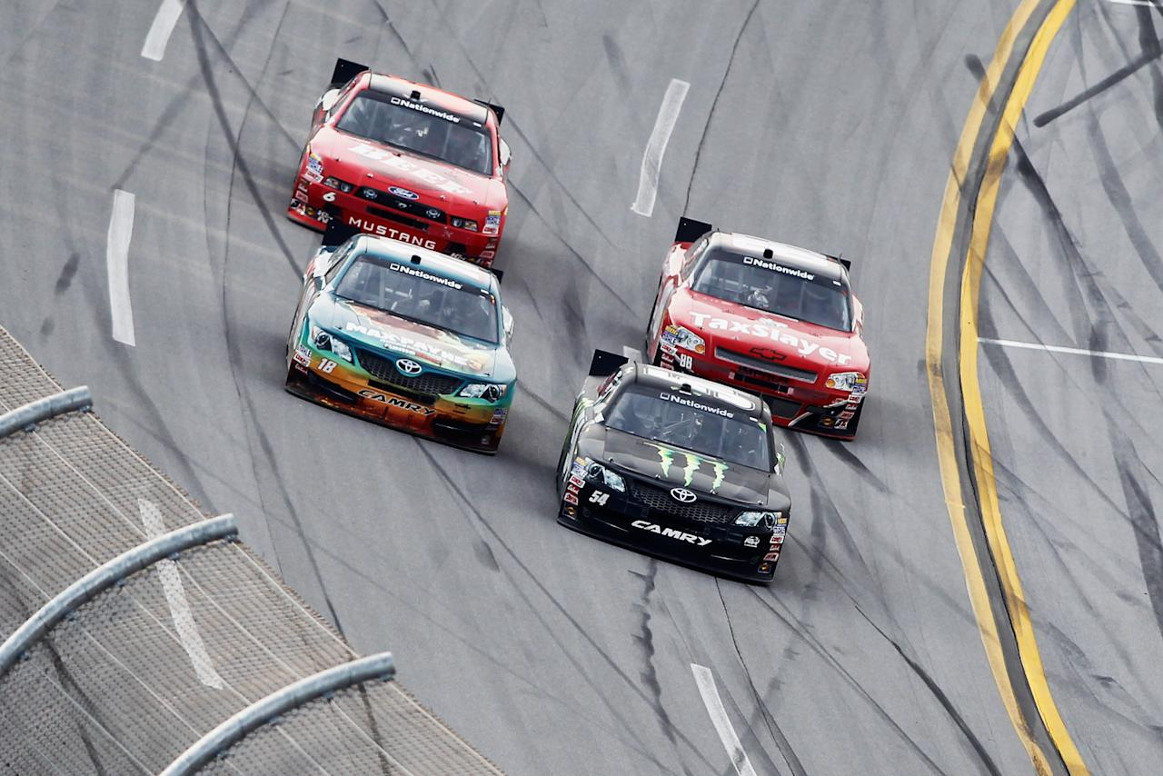 TALLADEGA, AL - MAY 05:  Joey Logano, driver of the #18 GameStop Toyota, passes Kyle Busch, driver of the #54 Monster Energy Toyota, to take the lead and win the NASCAR Nationwide Series Aaron's 312 at Talladega Superspeedway on May 5, 2012 in Talladega, Alabama.  (Photo by Todd Warshaw/Getty Images for NASCAR)