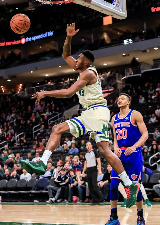 Milwaukee Bucks forward Thanasis Antetokounmpo of Greece (L) scores in front of New York Knicks forward Kevin Knox II (R) during the NBA game between the New York Knicks and the Milwaukee Bucks at Fiserv Forum in Milwaukee, Wisconsin, USA, 02 December 2019. The Bucks defeated the Knicks. EFE/TANNEN MAURY