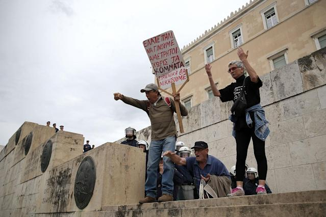 <p>Protesters stand on the stairs leading to the parliament as riot police block the way, during a demonstration marking a 24-hour general strike against the latest round of austerity Greece has agreed with its lenders, in Athens, Greece, May 17, 2017. (Costas Baltas/Reuters) </p>