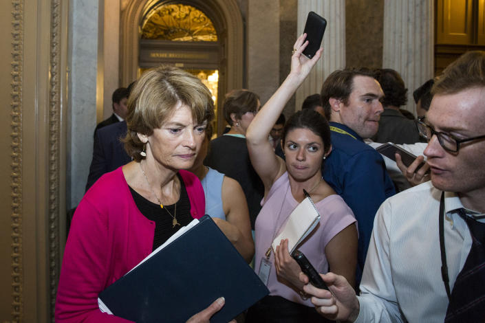 """Sen. Lisa Murkowski, R-Alaska, leaves the Senate chamber after a vote on a stripped-down, or """"skinny repeal,"""" version of Obamacare on July 28. (Photo: Zach Gibson/Getty Images)"""