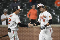 Baltimore Orioles' Ryan Mountcastle (6) is greeted by Austin Hays (21) after hitting a solo home run against Texas Rangers starting pitcher Glenn Otto during the fifth inning of a baseball game Thursday, Sept. 23, 2021, in Baltimore. (AP Photo/Terrance Williams)