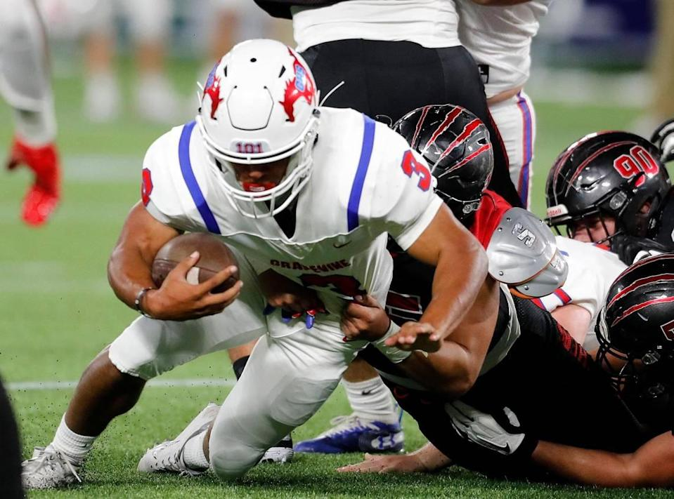 Grapevine running back Caleb Texada (3) is dropped behind the line during a high school football game at Globe Life Park in Arlington, Texas, Saturday, Sept. 26, 2020. Colleyville led 28-24 at the half. (Special to the Star-Telegram Bob Booth)