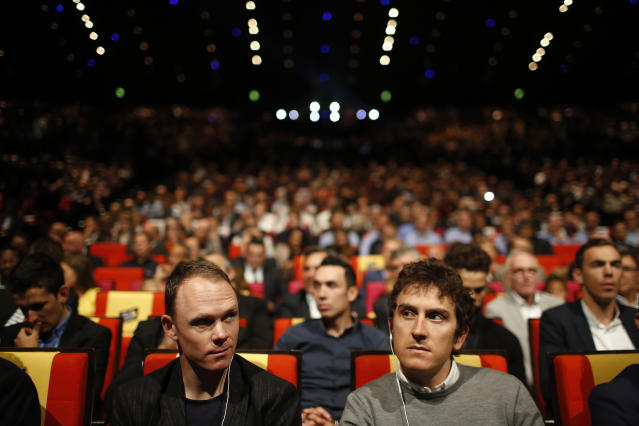 Britain's Chris Froome, left, and Geraint Thomas attend the presentation of the 2019 Tour de France cycling race, in Paris, Thursday Oct. 25, 2018. The 106th edition of the race starts on July 6 2019 to end on the Champs-Elysees avenue on July 28.(AP Photo/Thibault Camus)