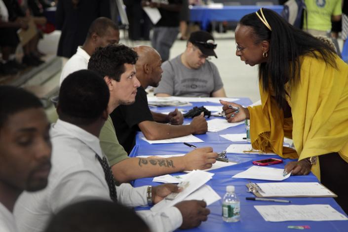 FILE - In this Tuesday, Aug. 21, 2012 file photo, job seekers fill out applications at a construction job fair in New York. U.S. employers added 96,000 jobs last month, the Labor Department said Friday, Sept. 7, 2012, a weak figure that could slow any momentum President Barack Obama hoped to gain from his speech to the Democratic National Convention. (AP Photo/Seth Wenig, File)