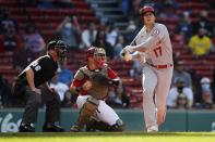 Los Angeles Angels' Shohei Ohtani (17) strikes out swinging in front of Boston Red Sox catcher Christian Vazquez, center, during the third inning of a baseball game, Saturday, May 15, 2021, in Boston. (AP Photo/Michael Dwyer)