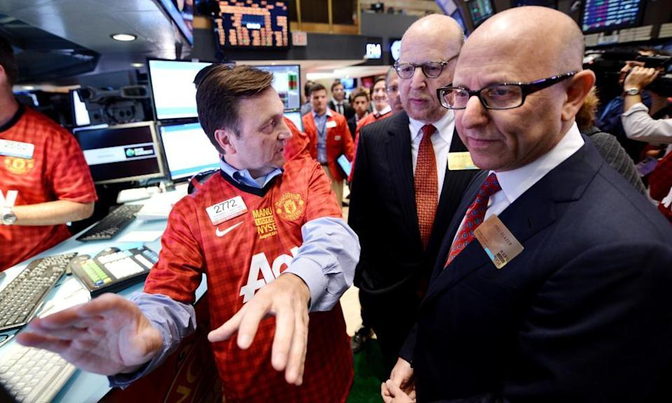 Joel and Avram Glazer at the initial public offering of Manchester United shares on the floor of the New York Stock Exchange in August 2012.