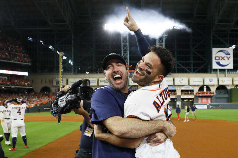 Jose Altuve celebrates his walk-off home run in Game 6 of the ALCS with Justin Verlander. (AP Photo/Matt Slocum)