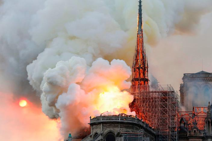 Smoke and flames rise during a fire at the landmark Notre-Dame Cathedral in central Paris on April 15, 2019, potentially involving renovation works being carried out at the site, the fire service said. (Photo: Pierre Galey/AFP/Getty Images)