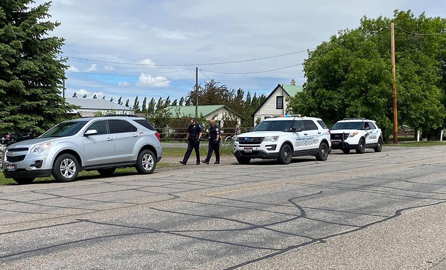 In this photo provided by East Idaho News shows authorities outside a home after serving a warrant in Salem, Idaho, on Tuesday June 9, 2020.