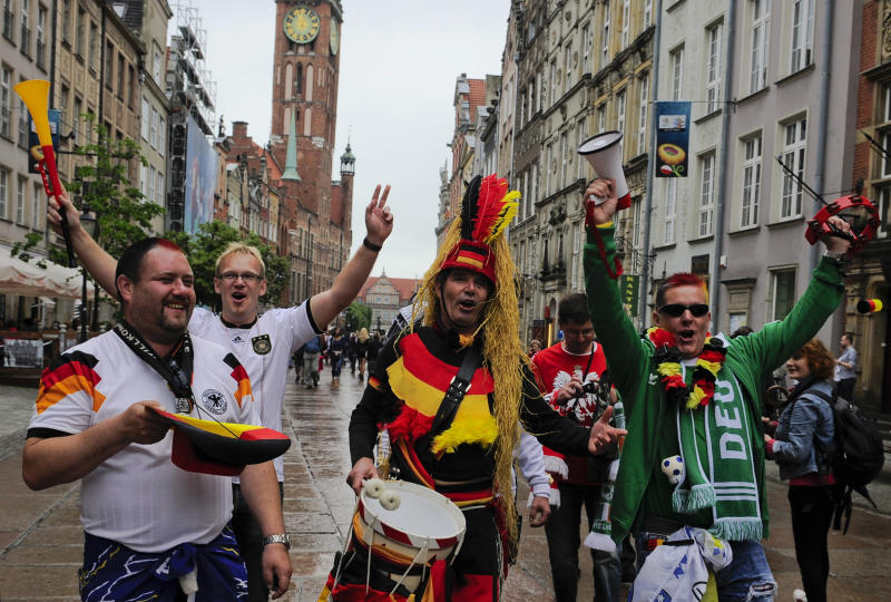 German fans cheer as they walk through the old city before the Euro 2012 soccer championship quarterfinal match between Germany and Greece in Gdansk, Poland, Friday, June 22, 2012. (AP Photo/Alvaro Barrientos)