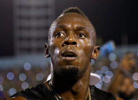 Jamaica's Olympic champion Usain Bolt looks up after winning his final 100 meters sprint at the 2nd Racers Grand Prix at the National Stadium in Kingston, Jamaica June 10, 2017. REUTERS/Gilbert Bellamy