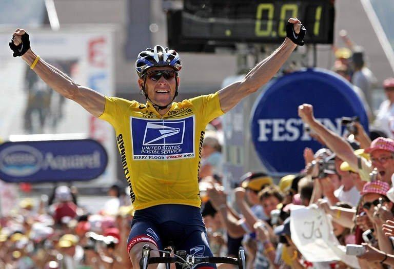 US cyclist Lance Armstrong celebrates as he crosses the finish line and wins the Tour de France on July 22, 2004