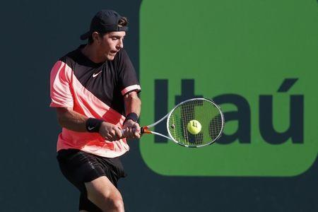 Mar 24, 2018; Key Biscayne, FL, USA; Thanasi Kokkinakis of Australia hits a backhand against Roger Federer of Switzerland (not pictured) on day five of the Miami Open at Tennis Center at Crandon Park. Mandatory Credit: Geoff Burke-USA TODAY Sports