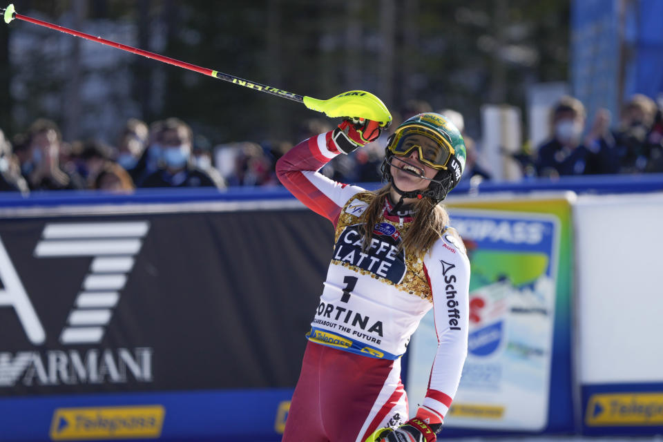 Austria's Katharina Liensberger celebrates after winning the women's slalom, at the alpine ski World Championships in Cortina d'Ampezzo, Italy, Saturday, Feb. 20, 2021. (AP Photo/Giovanni Auletta)