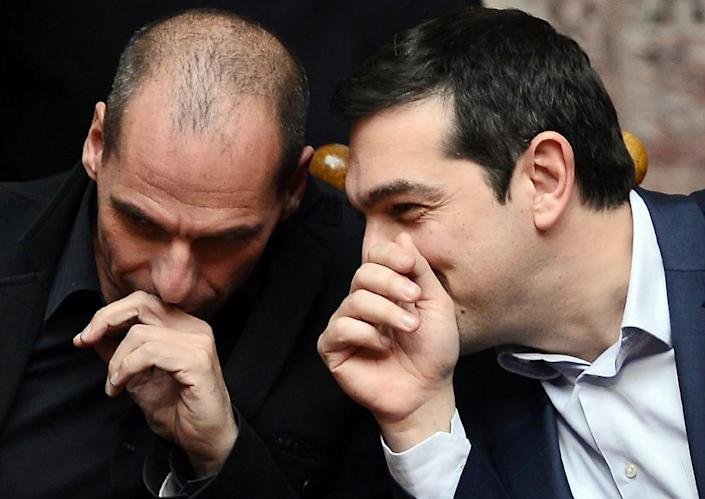 Yianis Varoufakis (left) with Alexis Tsipras at the Greek parliament in Athens on February 18, 2015 (AFP Photo/Louisa Gouliamaki)