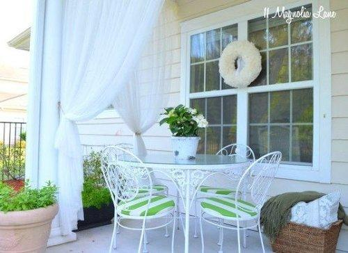 This blogger from 11 Magnolia Lane managed to find a solution for blocking bugs and neighbors by hanging these inexpensive curtains from Ikea.