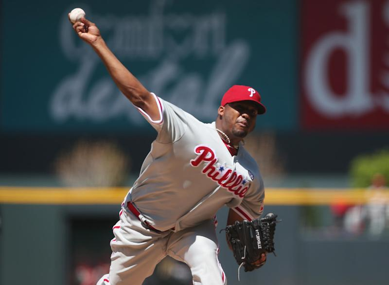Philadelphia Phillies starting pitcher Roberto Hernandez works against the Colorado Rockies in the first inning of a baseball game in Denver, Sunday, April 20, 2014. (AP Photo/David Zalubowski)