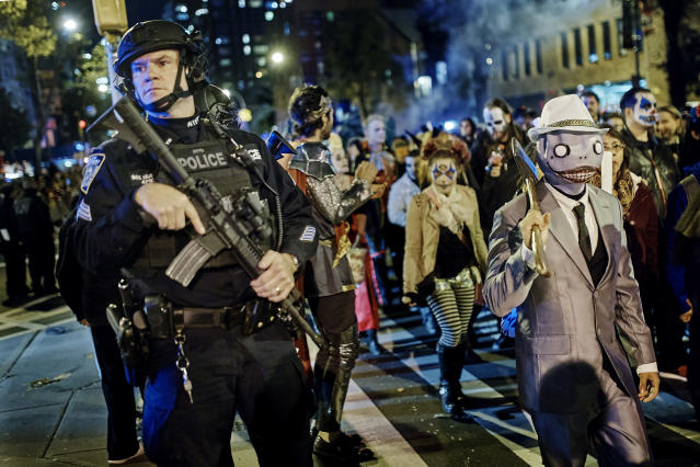 Heavily armed police guard revelers during the Village Halloween Parade on Oct. 31, 2017, in N.Y.C. The city's always surreal Halloween parade occurred under the shadow of real fear just hours after a truck attack killed several people on a busy bike path in what authorities called an act of terror. (Photo: Andres Kudacki/AP)