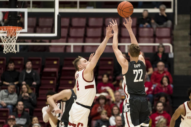 Washington State guard Ryan Rapp (22) shoots as Stanford guard Isaac White (4) defends during the first half of an NCAA college basketball game Saturday, Jan. 11, 2020, in Stanford, Calif. (AP Photo/John Hefti)