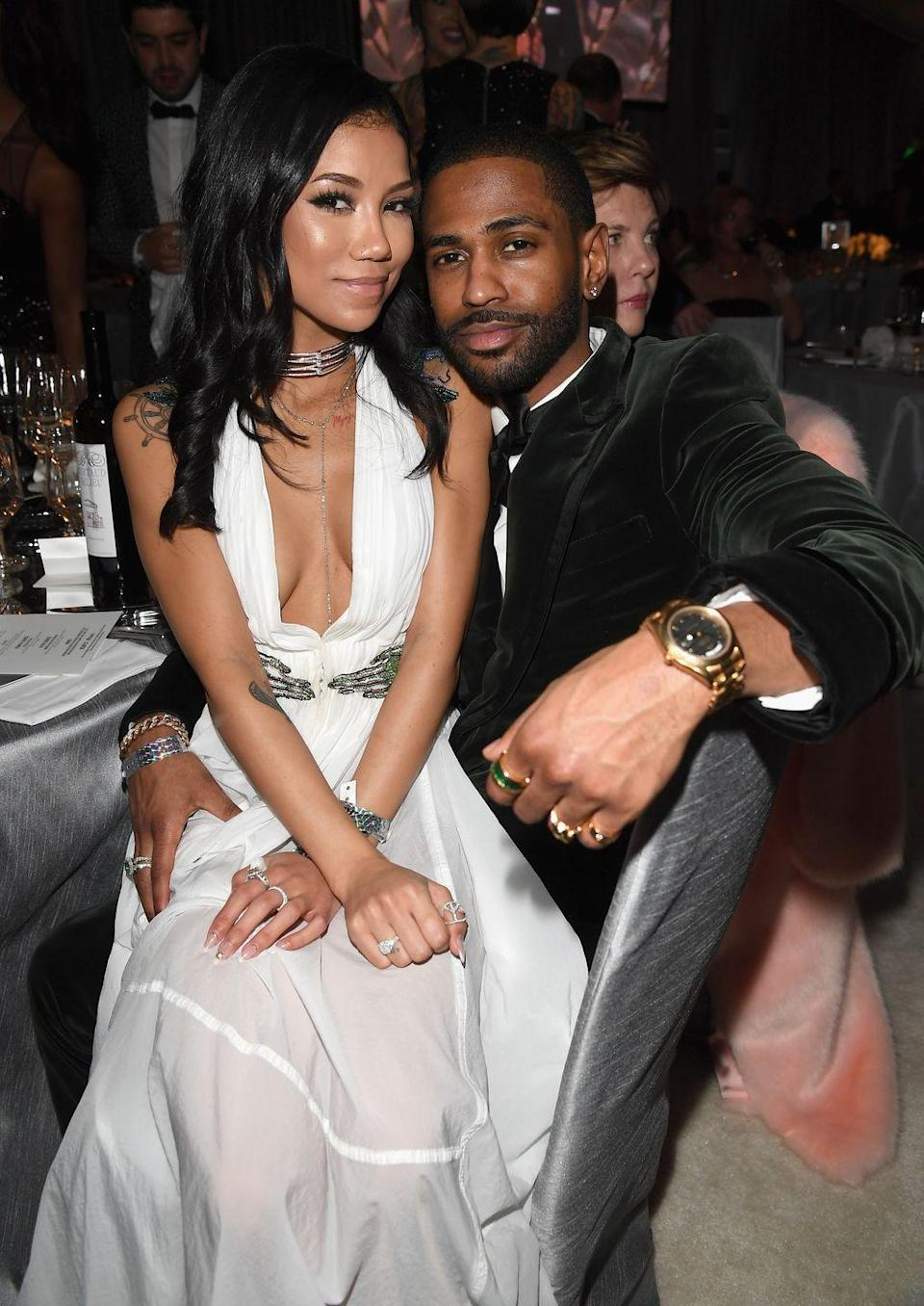 """<p>""""The way in which Jhené sits on Big Sean's lap tells us that there has been some longevity to their relationship and that they're highly comfortable with each other,"""" Donaldson says. </p><p>They're also touching heads, which signals that they have similar mindsets. Plus, Sean's hand on Jhené's leg screams intimacy. Both also point to the fact that Jhené and Big Sean's relationship is one that was long established. You wouldn't see a new couple posing like this, says Donaldson, at least not this convincingly.</p>"""
