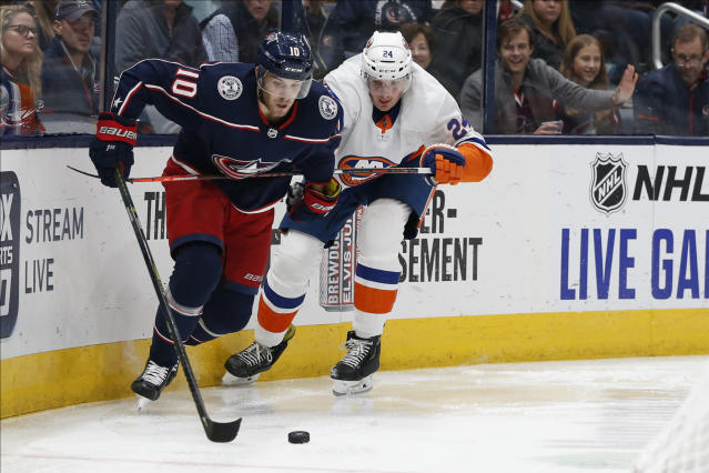 Columbus Blue Jackets' Alexander Wennberg, left, of Sweden, keeps the puck away from New York Islanders' Scott Mayfield during the second period of an NHL hockey game Saturday, Oct. 19, 2019, in Columbus, Ohio. (AP Photo/Jay LaPrete)