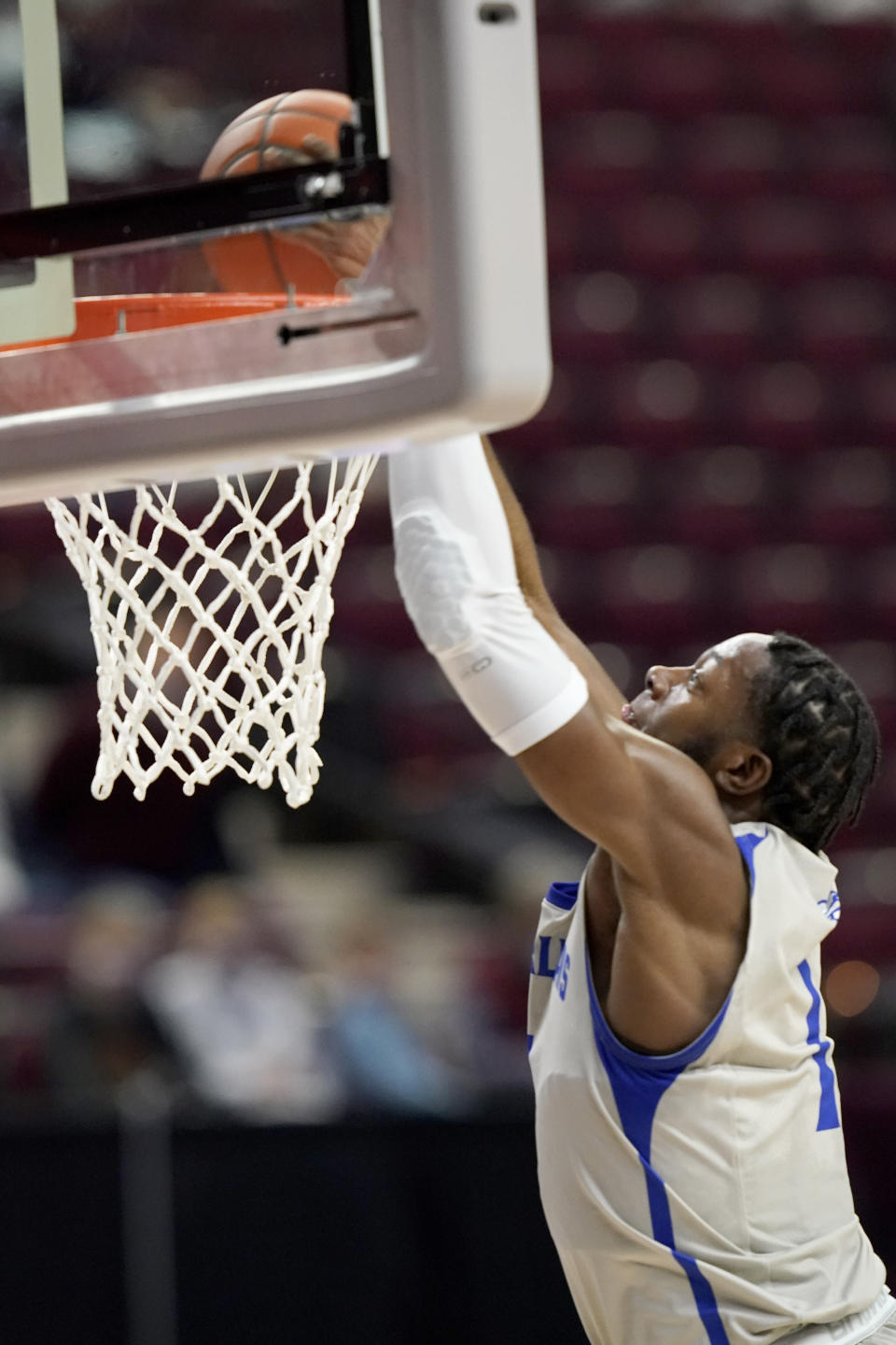 New Orleans guard Damion Rosser (1) dunks against Texas A&M during the first half of an NCAA college basketball game Sunday, Nov. 29, 2020, in College Station, Texas. (AP Photo/Sam Craft)