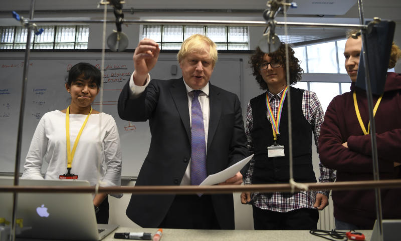 Britain's Prime Minister Boris Johnson, center left, visits the Department of Mathematics at King's Maths School, part of King's College London University, in London, Monday Jan. 27, 2020. (Daniel Leal-Olivas/Pool via AP)