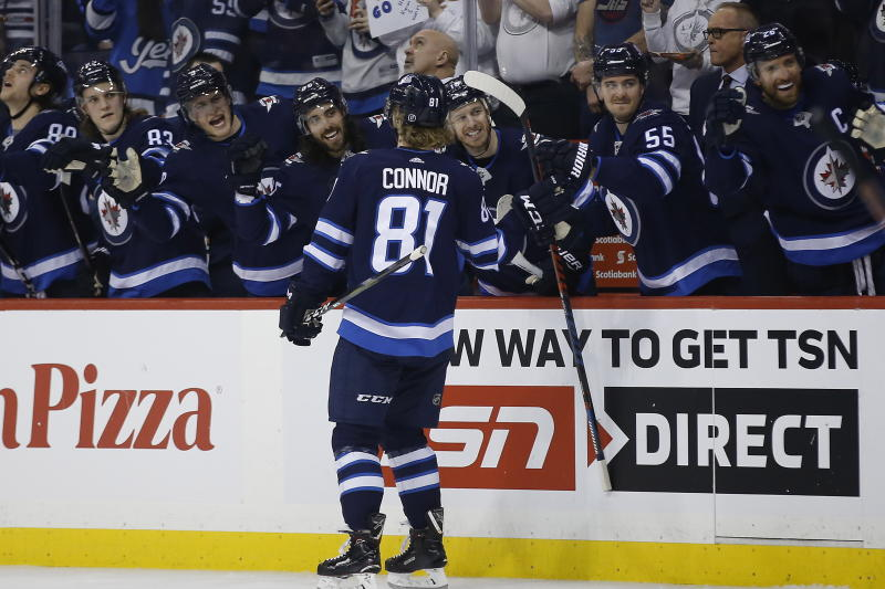 Winnipeg Jets celebrate from the bench as Kyle Connor (81) skates by during the second period of an NHL hockey game against the Nashville Predators, Saturday, March 23, 2019 in Winnipeg, Manitoba. (John Woods/Canadian Press via AP)