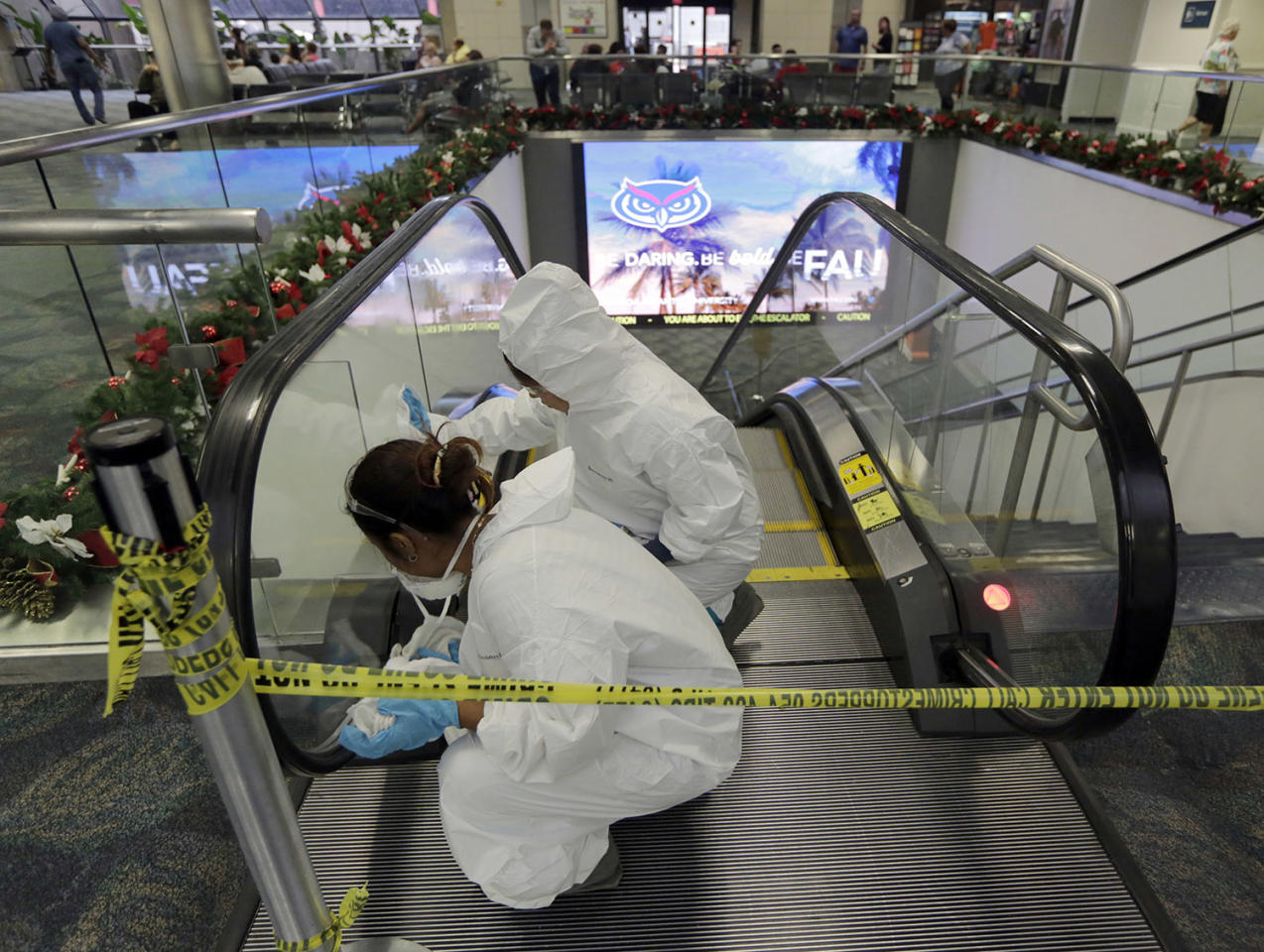 <p>Workers clean the escalators that lead to the baggage claim area at terminal 2 at the Fort Lauderdale-Hollywood International Airport in Fort Lauderdale, Fla., on Saturday, Jan. 7, 2017. (AP Photo/Alan Diaz) </p>