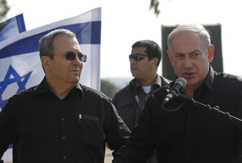 Israel's Prime Minister Benjamin, right, and Defense Minister Ehud Barak, left, speak to journalists during a tour of of a missile defense battery near the city of Ashkelon, southern Israel, Wednesday, 24 2012. Gaza militants pummeled southern Israel with dozens of rockets and mortars on Wednesday, and Israeli airstrikes killed two Palestinians in a sharp escalation of violence following a landmark visit to the coastal territory by the leader of Qatar.(AP Photo/ Tsafrir Abayov)