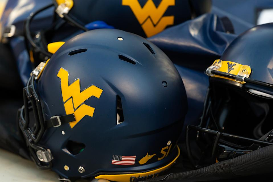 CHARLOTTE, NC - SEPTEMBER 01: West Virginia Mountaineers helmets on the sideline during the Belk College Kickoff between the West Virginia Mountaineers and the Tennessee Volunteers on September 1, 2018, at the Bank of America Stadium in Charlotte, North Carolina. West Virginia won the game 40-14. (Photo by Jay Anderson/Icon Sportswire via Getty Images)