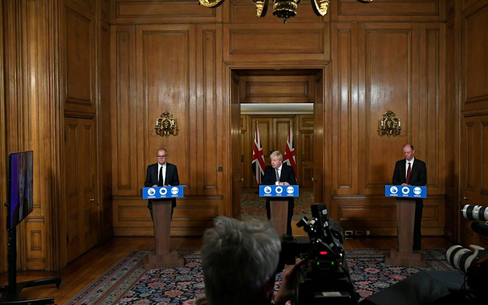 Britain's Prime Minister Boris Johnson, center, answers a question as he Chief Medical Officer Professor Chris Whitty, right, and Chief Scientific Adviser Sir Patrick Vallance attend a press conference in 10 Downing Street - Alberto Pezzali/AP