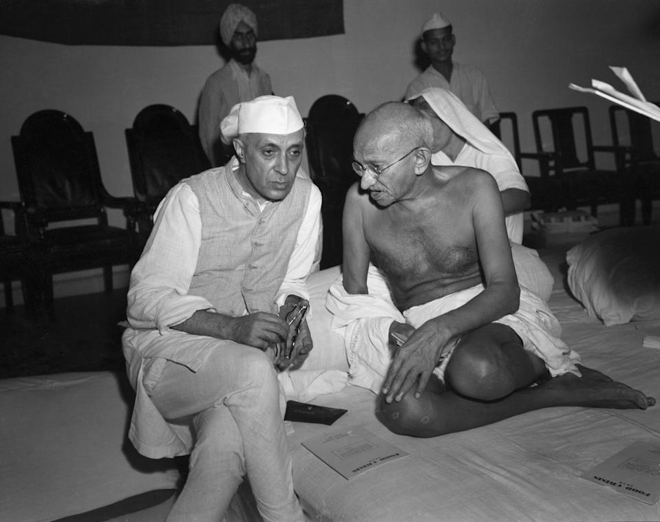 (Original Caption) 1946-Bombay, India: The architect of India's independence from Great Britain, Mahatma Gandhi (right) talks to his eventual successor, Rashtrapati Jawaharlal Nehru in 1946. Gandhi's name has become synonymous with non-violent opposition and political leverage, and his struggle in india has served as a model for political struggles around the world. BPA2 #2839