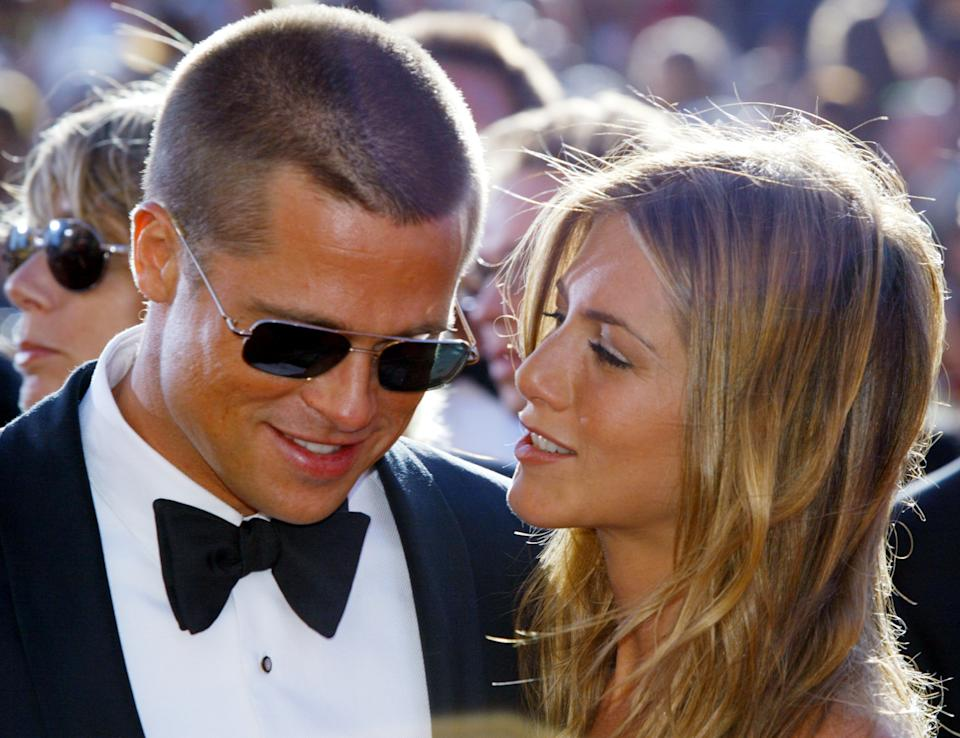 Brad Pitt and Jennifer Aniston arrive at the 56th annual Primetime Emmy Awards at the Shrine Auditorium in Los Angeles, in this September 19, 2004 file photo. Jennifer Aniston filed for divorce on March 25, 2005 from Brad Pitt, some two and a half months after Hollywood's golden couple announced they were separating, court papers in Los Angeles showed. REUTERS/Kimberly White/Files  SV/PN