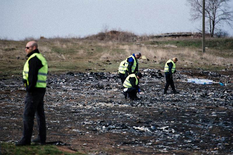 Dutch investigators work at the crash site of the Malaysia Airlines Flight MH17 near the village of Grabove in eastern Ukraine on March 24, 2015