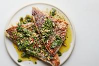 """You're bound to get plenty of accolades for this zesty sauce, a Middle Eastern–spiced riff on herby salsa verde. <a href=""""https://www.epicurious.com/recipes/food/views/broiled-red-snapper-with-zaatar-salsa-verde?mbid=synd_yahoo_rss"""" rel=""""nofollow noopener"""" target=""""_blank"""" data-ylk=""""slk:See recipe."""" class=""""link rapid-noclick-resp"""">See recipe.</a>"""