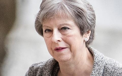 """AnIslamicState fanatic plotted to assassinate Prime Minister Theresa May in a suicide attack on 10 Downing Street, a court has heard. Naa'imur Zakariyah Rahman, 20, was encouraged to cause carnage in Britain by an uncle who had joined Isiland died in a drone strike in Syria, jurors were told. He allegedly thought he was just days away from inflicting """"lethal violence"""" with a knife and a suicide vestbefore his arrest last November. But his plan was uncovered by a two-yearMI5 surveillance operation which involved anagent posingas a senior Isilofficial in Syria, the Old Bailey heard. Prosecutor Mark Heywood QC read out Telegram chat in which Rahman was allegedly snared by the fake Amir. On September 14 last year, Rahman said: """"Can you put me in a sleeper cell ASAP?I want to do a suicide bomb on Parliament. I want to attempt to kill Theresa May."""" The next day, he said: """"My objective is to take out my target. Nothing less than the death of the leaders of Parliament."""" The court heard Rahman went on to praise the Manchester arena bomber, saying he """"did well"""". The Isil fanatic is accused of plotting to kill Theresa May (pictured) Credit: Peter Macdiarmid/LNP He allegedly said he thought about wearing """"a vest"""", driving past Parliament and """"pushing the button"""" to """"clear the entire block"""". Jurors heard he said: """"Everyone inside, including the Prime Minister would be dead."""" Rahman talked about the MI5 building but allegedly said: """"Getting outside Parliament when all the leaders are there is simple, you can walk right outside."""" On September 23 last year, Rahman also said he had an idea based on what his uncle had told him about the Isil development of poison, jurors were told. Rahman is accused of conducting reconnaissance, recording a pledge of allegiance, and delivering a rucksack and jacket to be fitted with explosives. On November 1, Rahman was introducedto another member of the network called Shaq, an undercover police officer, to help him get a blade and suicide vest. Rahm"""