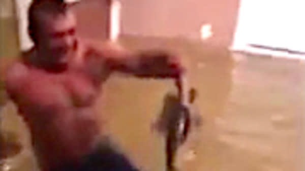 Man Catches Fish With His Hands Inside Home Flooded By Harvey