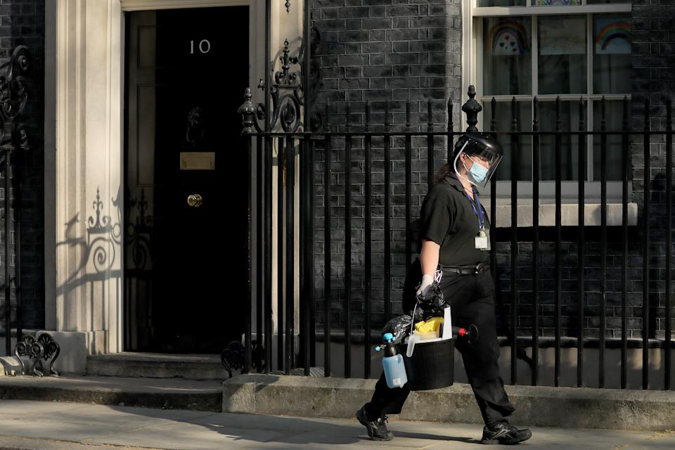 "LONDON, April 16, 2020 .A cleaner wearing face mask leaves 10 Downing Street in London, Britain, on April 16, 2020. The British government announced on Thursday that the current restrictive measures that aim to contain the spread of the novel coronavirus will remain in place for ""at least three weeks"".  As of Thursday morning, 103,093 people in Britain tested positive for COVID-19, said the Department of Health and Social Care. (Photo by Tim Ireland/Xinhua) (Xinhua/ via Getty Images)"
