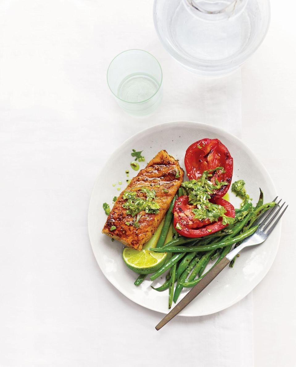 """<p>Break out the grill early for this spicy and smoky dish, drizzled with a bright and punchy cilantro vinaigrette.</p><p><em><a href=""""https://www.goodhousekeeping.com/food-recipes/a14285/grilled-cajun-salmon-tomatoes-green-beans-recipe-wdy0712/"""" rel=""""nofollow noopener"""" target=""""_blank"""" data-ylk=""""slk:Get the recipe for Grilled Cajun Salmon, Tomatoes, and Green Beans »"""" class=""""link rapid-noclick-resp"""">Get the recipe for Grilled Cajun Salmon, Tomatoes, and Green Beans »</a></em></p><p><strong>RELATED: </strong><a href=""""https://www.goodhousekeeping.com/food-recipes/g413/great-grilling-recipes/"""" rel=""""nofollow noopener"""" target=""""_blank"""" data-ylk=""""slk:60+ Insanely Delicious Grilling Recipes to Try ASAP"""" class=""""link rapid-noclick-resp"""">60+ Insanely Delicious Grilling Recipes to Try ASAP</a><br></p>"""