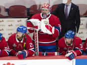 Montreal Canadiens goaltender Carey Price (31) watches from the bench after being pulled for an extra attacker during the third period of Game 3 against the Tampa Bay Lightning in the NHL hockey Stanley Cup Final, Friday, July 2, 2021, in Montreal. (Ryan Remiorz/The Canadian Press via AP)