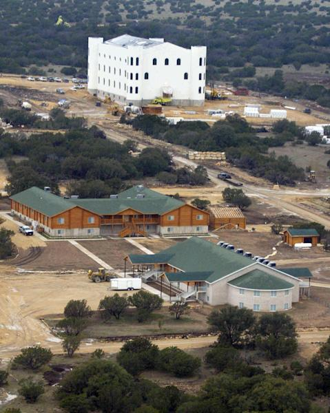 FILE - In this March 2, 2005 aerial file photo, the Fundamentalist Church of Jesus Christ of Latter Day Saints compound is shown under construction near Eldorado, Texas. Texas wants to take ownership of the polygamist ranch where the convicted sect leader Warren Jeffs and his followers sexually assaulted children. The Texas attorney general's office filed a seizure warrant in rural Schleicher County on Wednesday, Nov. 28, 2012. (AP Photo/Donna McWilliam, File)