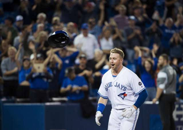 Toronto Blue Jays' Justin Smoak reacts after hitting the game-winning home run against the Tampa Bay Rays in a baseball game in Toronto on Thursday, Sept. 20, 2018. (Nathan Denette/The Canadian Press via AP)