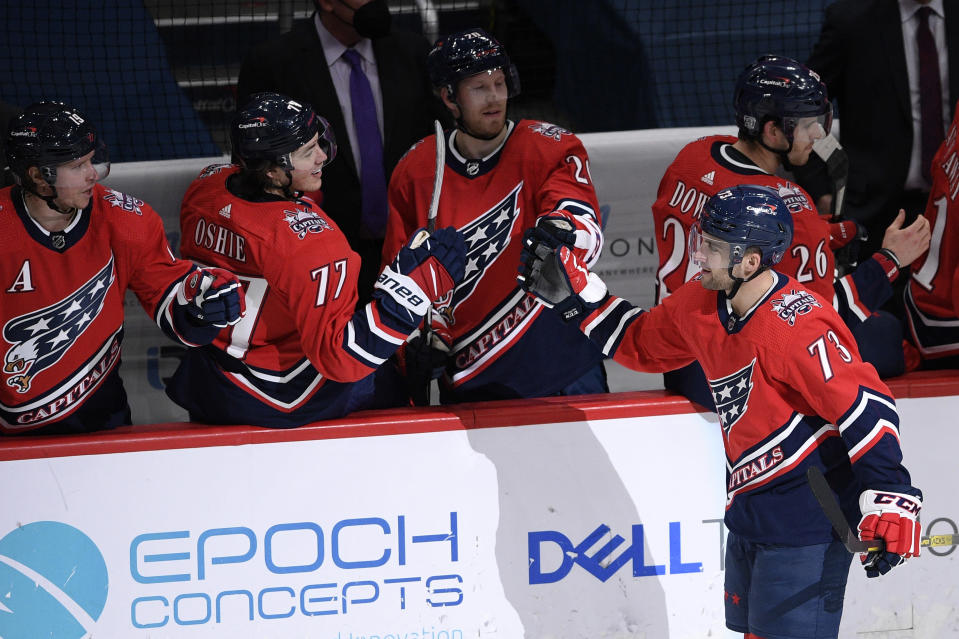 Washington Capitals left wing Conor Sheary (73) celebrates his goal with center Lars Eller (20), right wing T.J. Oshie (77) and center Nicklas Backstrom, left, during the second period of an NHL hockey game against the Pittsburgh Penguins, Tuesday, Feb. 23, 2021, in Washington. (AP Photo/Nick Wass)